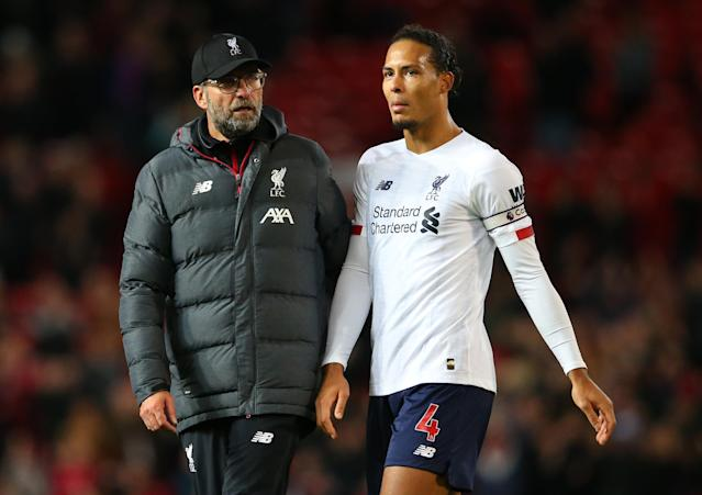 Jurgen Klopp, Virgil van Dijk and Liverpool have a healthy advantage atop the Premier League right now, but where might they slip up? (Photo by Alex Livesey/Getty Images)