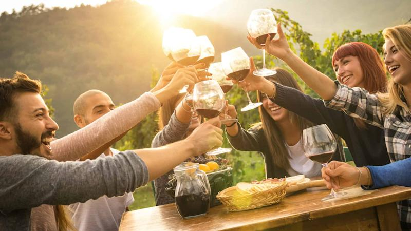 Friends celebrating with wine