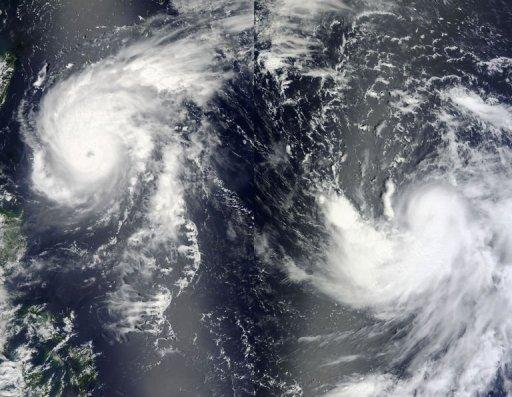 Typhoon Tembin (L) and Tropical Storm Bolaven (R) are pictured on August 21 in the Philippine Sea