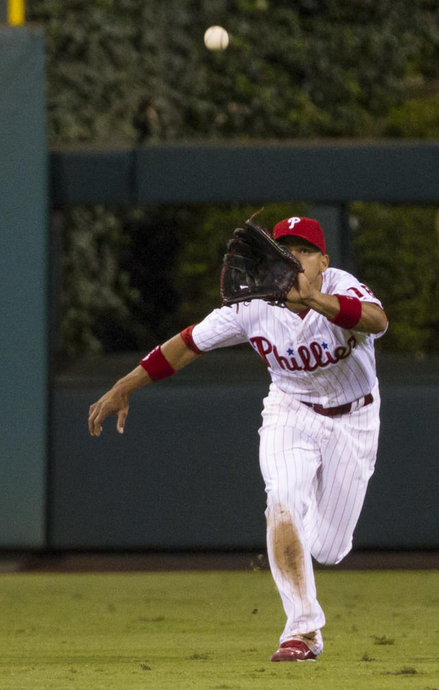 Philadelphia Phillies center fielder Cesar Hernandez keeps his eye on the ball hit by Miami Marlins' Christian Yelich during the fourth inning of a baseball game, Tuesday, Sept. 17, 2013, in Philadelphia. Hernandez made the catch. (AP Photo/Chris Szagola)