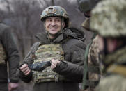 FILE - In this Thursday, Feb. 11, 2021 file photo, Ukrainian President Volodymyr Zelenskyy talks with servicemen as he visits the war-hit Donetsk region, eastern Ukraine. Ukraine's leader is traveling to the United States in hopes of bolstering security ties with Washington and persuading the Biden administration to ramp up sanctions against a new Russian gas pipeline that bypasses his country. (Ukrainian Presidential Press Office via AP, File)