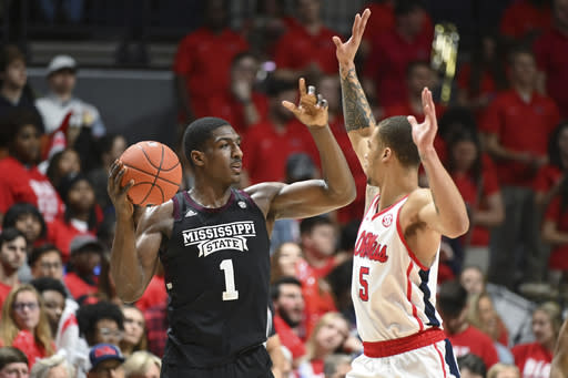 Mississippi State forward Reggie Perry (1) looks for room past Mississippi forward KJ Buffen (5) during the second half of an NCAA college basketball game in Oxford, Miss., Tuesday, Feb. 11, 2020. Mississippi won 83-58. (AP Photo/Thomas Graning)