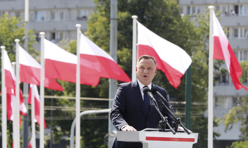 Poland's president Andrzej Duda, gives an address during the annual Armed Forces review during a national holiday, in Katowice, Poland, Thursday, Aug. 15, 2019. Large crowds turned out for the celebration which this year included a fly-over by two U.S. F-15 fighter jets. (AP Photo/Czarek Sokolowski)
