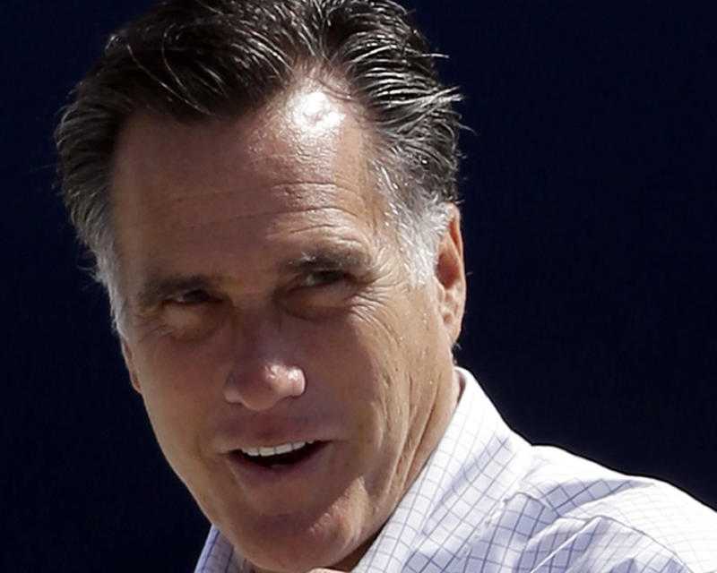 FILE - In this Sept. 23, 2012 file photo, Republican presidential candidate, former Massachusetts Gov. Mitt Romney gets ready to board his campaign plane in Los Angeles. Never have American voters re-elected a president whose work they disapprove of as much as Barack Obama. Not that Mitt Romney can take much comfort _ they've never elected a challenger with such high disapproval ratings, either.   (AP Photo/Charles Dharapak, File)