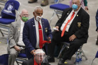 """FILE - In this June 11, 2020 file photo, New Hampshire Rep. Al Baldasaro (R-Londonderry) wears a """"Trump 2020"""" face mask as he walks among his colleagues during a legislative session in Durham, N.H. at the Whittemore Center at the University of New Hampshire. After only their first few weeks of work, tensions already are high among lawmakers meeting in-person at some state capitols — not because of testy debates over taxes, guns or abortion, but because of a disregard for coronavirus precautions. (AP Photo/Charles Krupa, File)"""