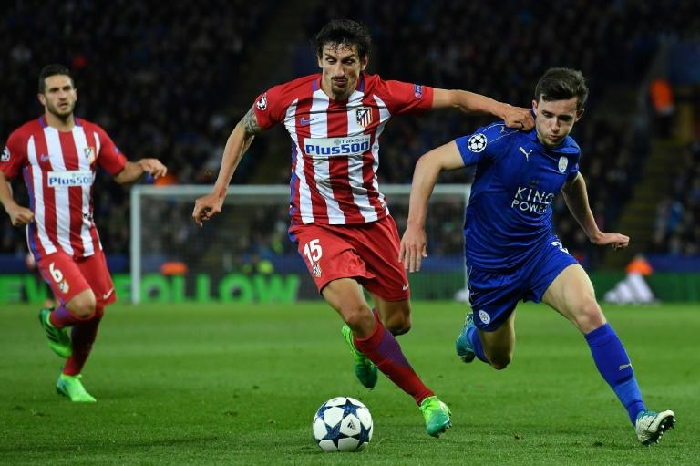 Atletico Madrid's defender Stefan Savic (C) vies with Leicester City's defender Ben Chilwell during the UEFA Champions League quarter-final second leg football match April 18, 2017
