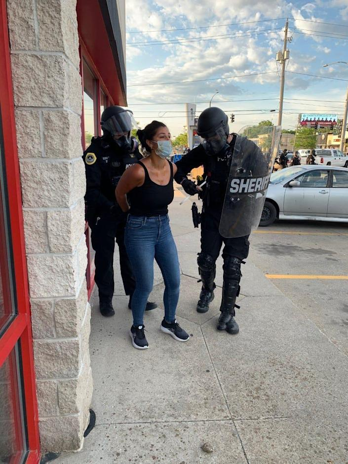 Des Moines Register reporter Andrea Sahouri is arrested by Des Moines police May 31 while covering a protest near Merle Hay Mall.