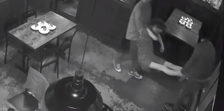 """Potentially life-threatening"": A woman can be seen being carried from the restaurant on the CCTV (NSW Liquor & Gaming Authority)"