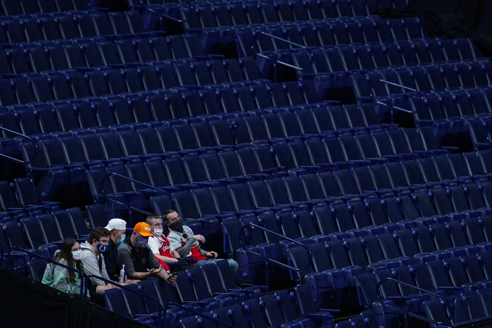 Fans sit in the stands in Lucas Oil Stadium during the first half of an NCAA college basketball game between Maryland and Michigan State at the Big Ten Conference tournament in Indianapolis, Thursday, March 11, 2021. (AP Photo/Michael Conroy)