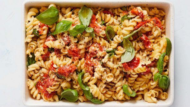 PHOTO: A one-pan pasta with roasted tomatoes, herbs and feta cheese. (Beatriz Da Costa for The New York Times. Food Styling: Rebecca Jurkevich.)
