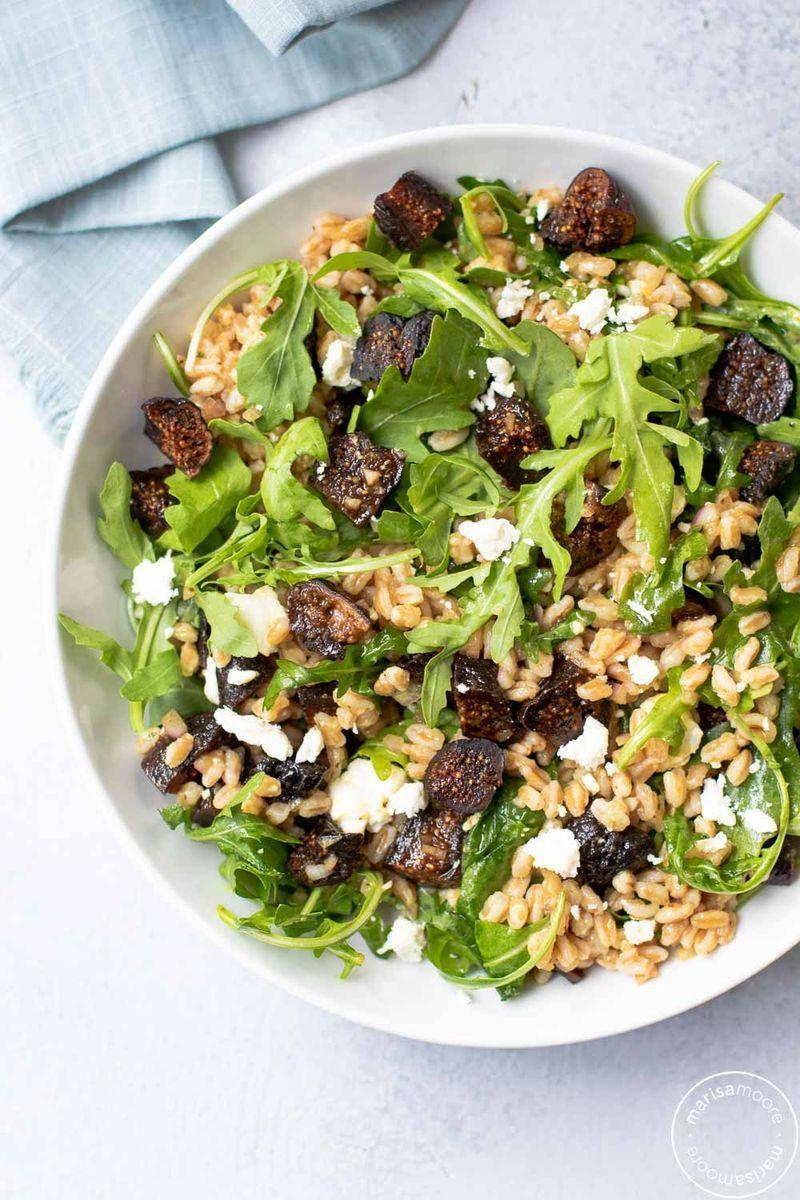 """<p>Sweet dried figs, hearty farro, tart goat cheese and bitter arugula combine to make a delicious and filling holiday salad.</p><p><strong>Get the recipe at <a href=""""https://marisamoore.com/fig-farro-salad/"""" rel=""""nofollow noopener"""" target=""""_blank"""" data-ylk=""""slk:Marisa Moore"""" class=""""link rapid-noclick-resp"""">Marisa Moore</a>.</strong> </p>"""