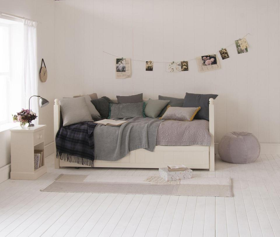 """<p>Daybeds are a fab option for a child who doesn't want a 'single' bed anymore. Choose a design with storage underneath so the space can stay as clutter-free as possible and match the bedside too. This whole scheme has a lovely calming feel about it and shows how off-whites can work well with mauves and greys.</p><p>Pictured: Fargo daybed, <a href=""""https://www.littlefolksfurniture.co.uk/ranges/fargo/fargo-daybed-storage-sleepover-trundle-ivory-white.html"""" rel=""""nofollow noopener"""" target=""""_blank"""" data-ylk=""""slk:Little Folks Furniture"""" class=""""link rapid-noclick-resp"""">Little Folks Furniture</a></p>"""