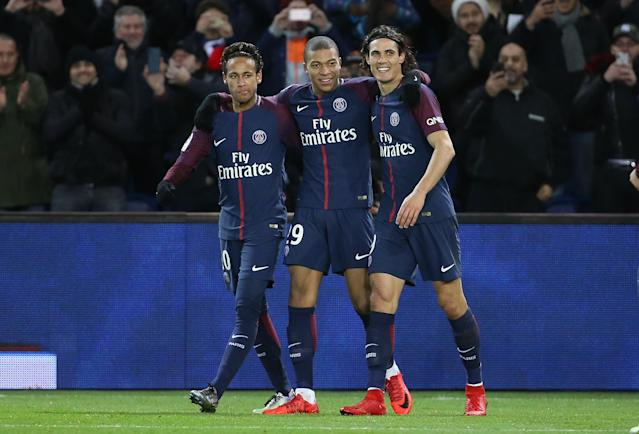 Neymar and Kylian Mbappe (left and center) cost PSG almost $500 million. (Getty)