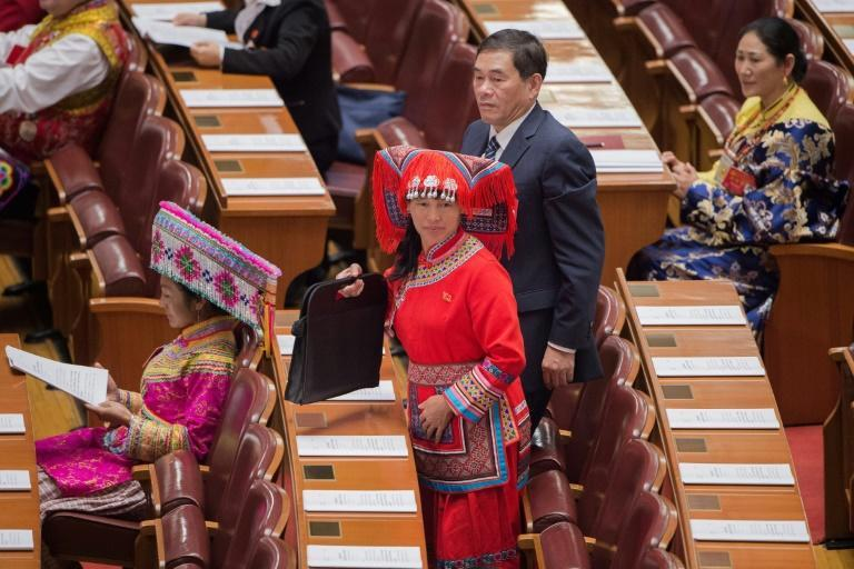 Women represent only a quarter of the 2,300 delegates attending the week-long congress held just twice a decade, highlighting China's yawning gender gap