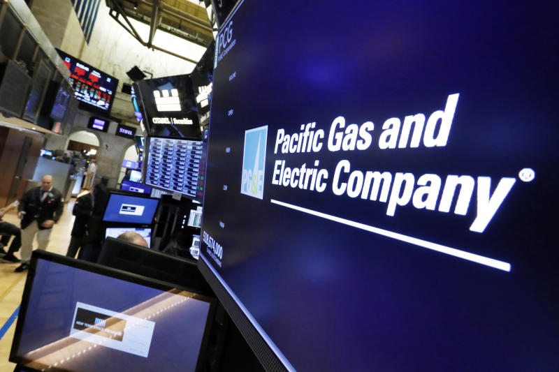 """FILE - This Jan. 14, 2019, file photo shows the logo for Pacific Gas & Electric Co. above a trading post on the floor of the New York Stock Exchange. A group of insurance companies are offering a plan to take over Pacific Gas & Electric, the latest to offer competing proposals to pay the utility's wildfire liabilities and pull it out of bankruptcy. In court filings Tuesday, July 23, 2019, the insurers said PG&E Corp. owes them more than $20 billion in claims paid to victims of recent California wildfires caused by PG&E equipment and offered a """"viable path"""" to emerge from bankruptcy. (AP Photo/Richard Drew, File)"""