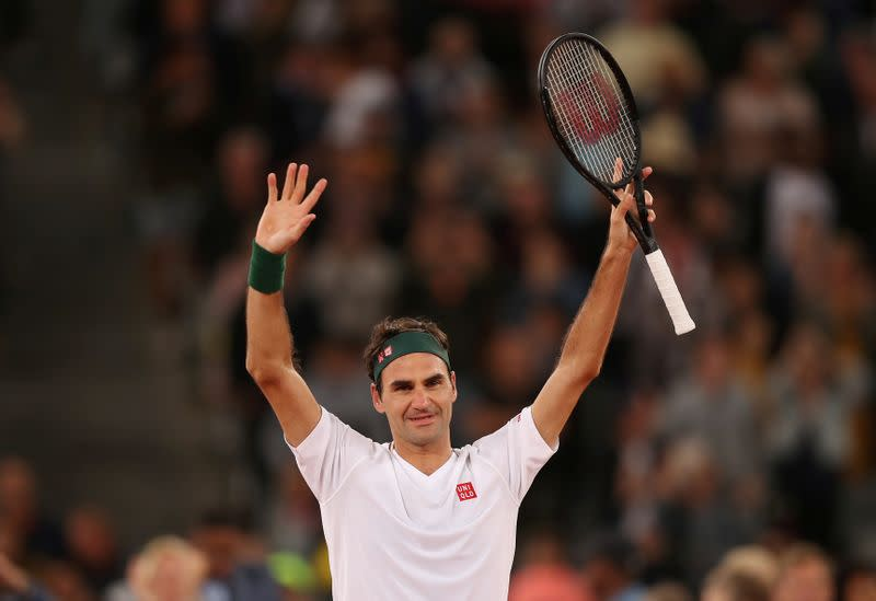 FILE PHOTO: Roger Federer celebrates after winning an exhibition match against Spain's Rafael Nadal