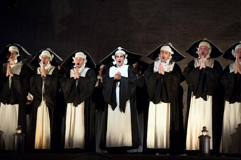"""In this Jan. 14, 2013 photo provided by the Metropolitan Opera, Juan Diego Florez, center, performs in the role of Count Ory during a dress rehearsal of Rossini's """"Le Comte Ory,"""" at the Metropolitan Opera in New York. (AP Photo/Metropolitan Opera, Marty Sohl)"""