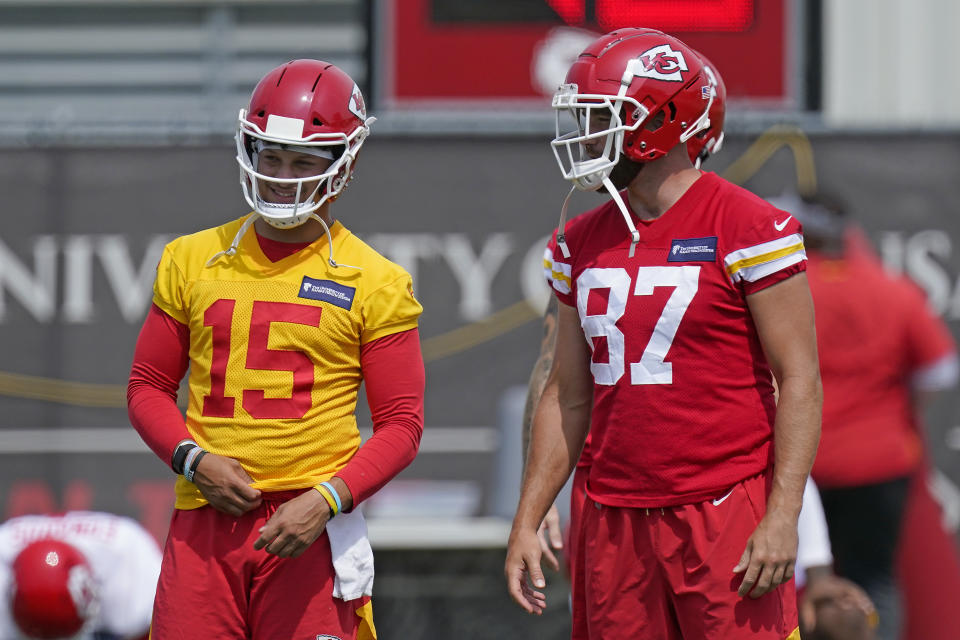 Kansas City Chiefs quarterback Patrick Mahomes (15) talks with tight end Travis Kelce (87) during practice. (AP Photo/Charlie Riedel)