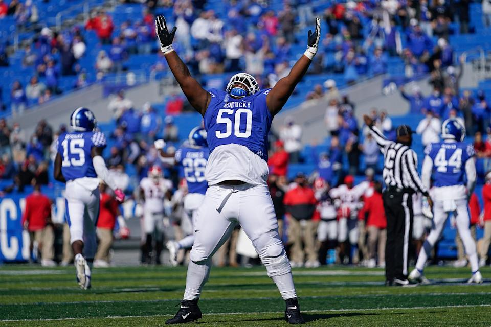 Kentucky defensive tackle Marquan McCall (50) celebrates an interception during the first half of an NCAA college football game against Georgia, Oct. 31, 2020, in Lexington, Ky.