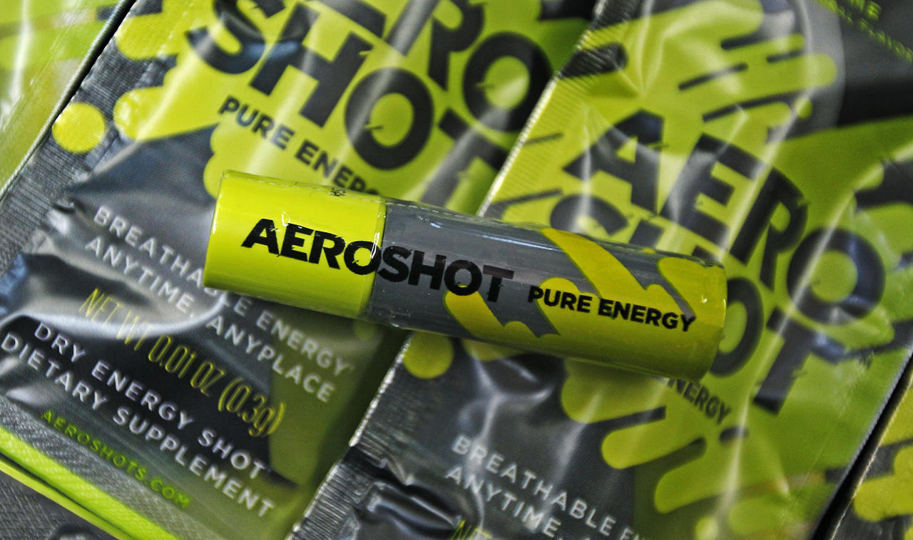 """An """"Aero Shot"""" caffeine device is displayed in Boston, Tuesday Feb. 7, 2012. The lipstick-sized product went on the market late last month in Massachusetts and New York, and is also available in France. A single unit costs $2.99 at convenience, mom-and-pop, liquor and online stores. (AP Photo/Charles Krupa)"""