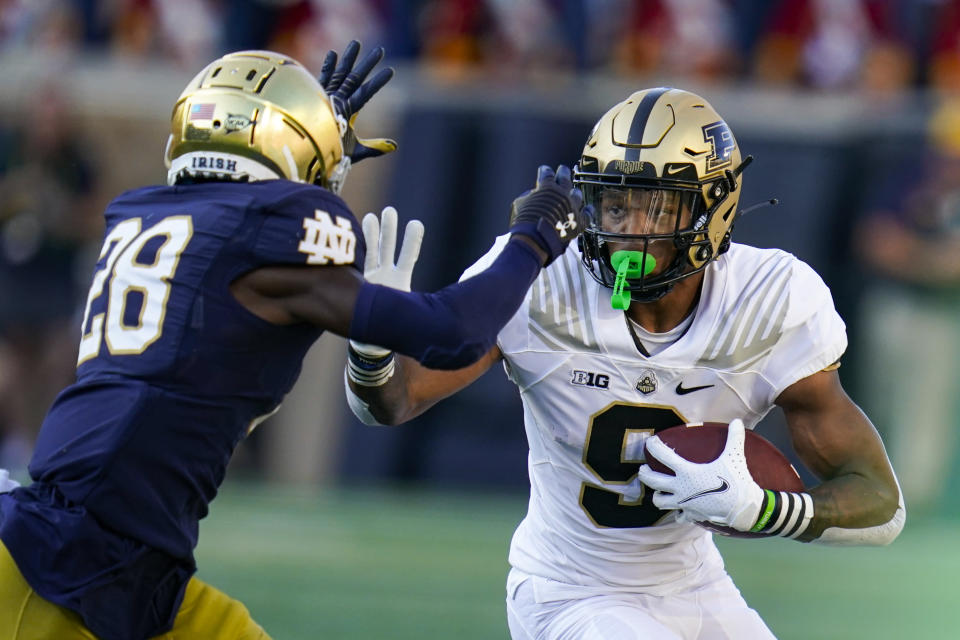 Purdue wide receiver Mershawn Rice (9) tries to get past Notre Dame cornerback TaRiq Bracy (28) during the second half of an NCAA college football game in South Bend, Ind., Saturday, Sept. 18, 2021. Notre Dame defeated Purdue 27-13. (AP Photo/Michael Conroy)