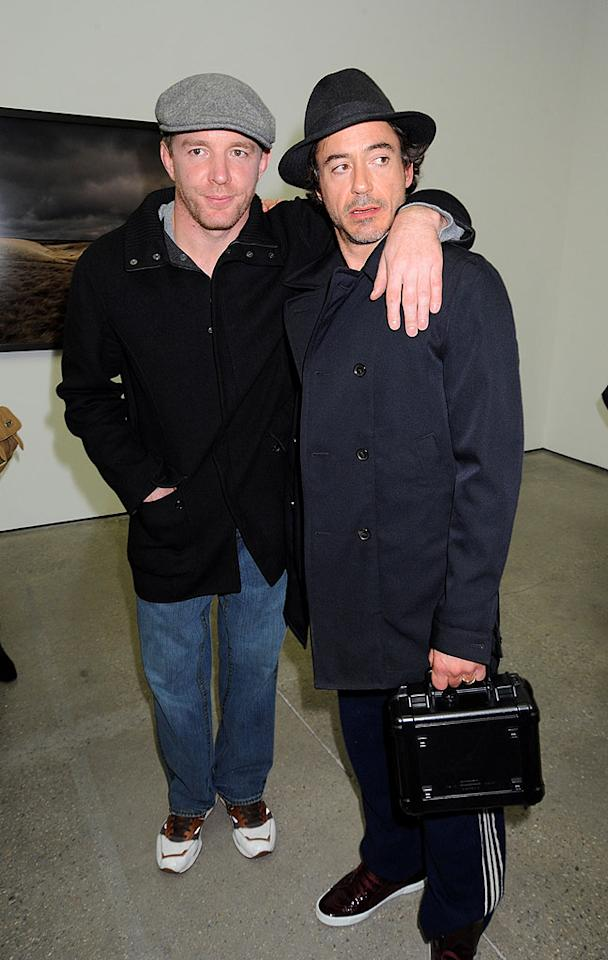 "Meanwhile, Madonna's estranged husband Guy Ritchie stayed in his native England, where he and Robert Downey Jr. enjoyed a boys night out. Ritchie is directing Downey Jr. in ""Sherlock Holmes,"" due out next year. Dave M. Benett/<a href=""http://www.gettyimages.com/"" target=""new"">GettyImages.com</a> - October 23, 2008"