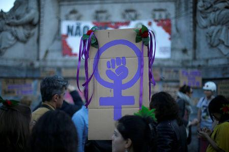 FILE PHOTO: Women attend a meeting to mark International Women's Day in downtown Lisbon, Portugal March 8, 2017. REUTERS/Rafael Marchante/File Photo