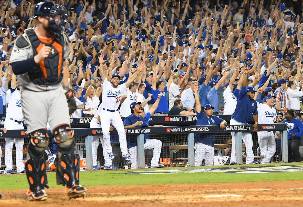 <p>Los Angeles Dodgers players including Charlie Culberson (37) celebrate in the dugout after defeating the Houston Astros in game one of the 2017 World Series at Dodger Stadium. Mandatory Credit: Jayne Kamin-Oncea-USA TODAY Sports </p>