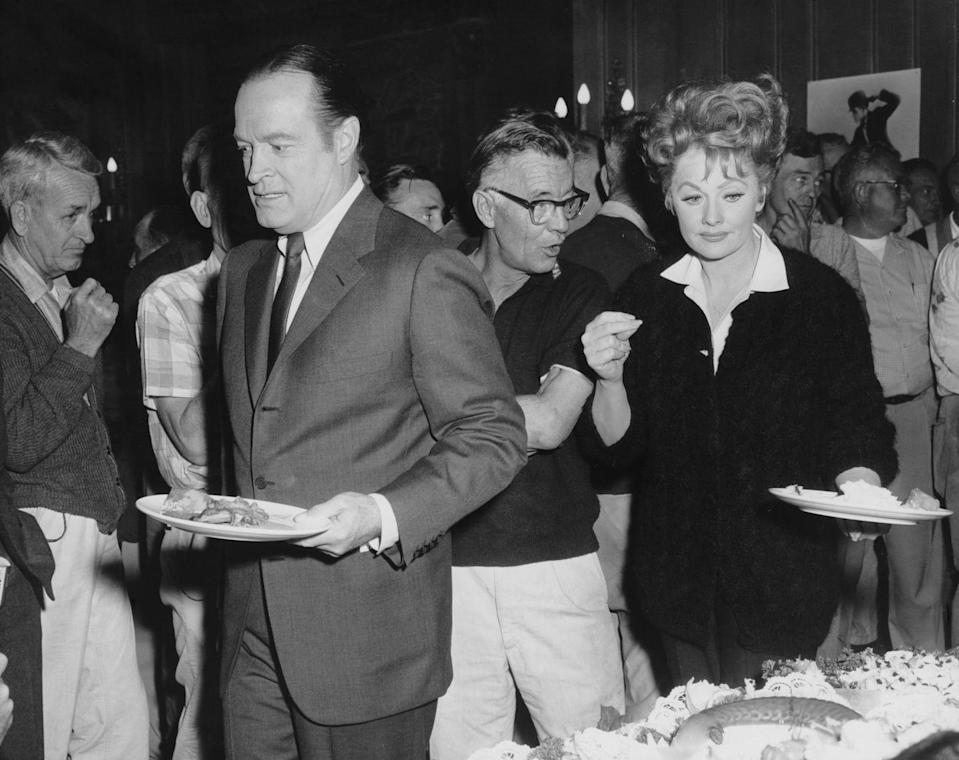<p>Lucille and Bob Hope make their way through the set's catering buffet line, while filming <em>Critic's Choice </em>in 1963. </p>