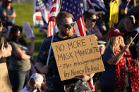 """FILE - In this Sept. 5, 2020, file photo, people gather during a """"Trash Your Mask Protest"""" rally hosted by the Utah Business Revival at the Utah State Capitol in Salt Lake City. Virus cases are surging across Europe and many U.S. states, but responses by leaders are miles apart, with officials in Ireland, France and elsewhere imposing curfews and restricting gatherings even as some U.S. governors resist mask mandates or more aggressive measures. (AP Photo/Rick Bowmer, File)"""