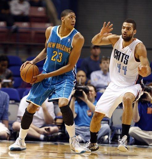New Orleans Hornets forward, Anthony Davis, left, works the ball to the basket against Charlotte Bobcats forward Jeffrey Taylor, right, in the first half of a preseason NBA basketball game in North Charleston, S.C., Thursday, Oct. 11, 2012. (AP Photo/Mic Smith)
