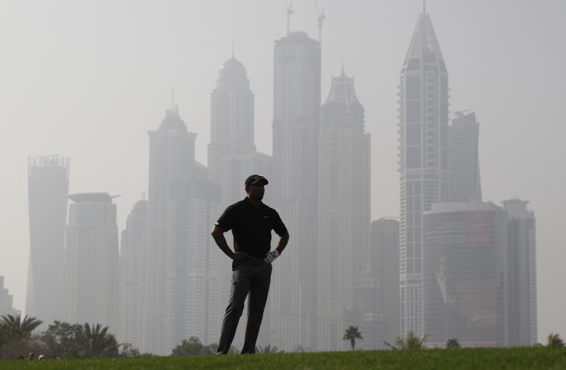 Tiger Woods from the U.S. studies a play on the 13th hole during the second round of the Dubai Desert Classic golf tournament in Dubai, United Arab Emirates, Friday Jan. 31, 2014. (AP Photo/Kamran Jebreili)