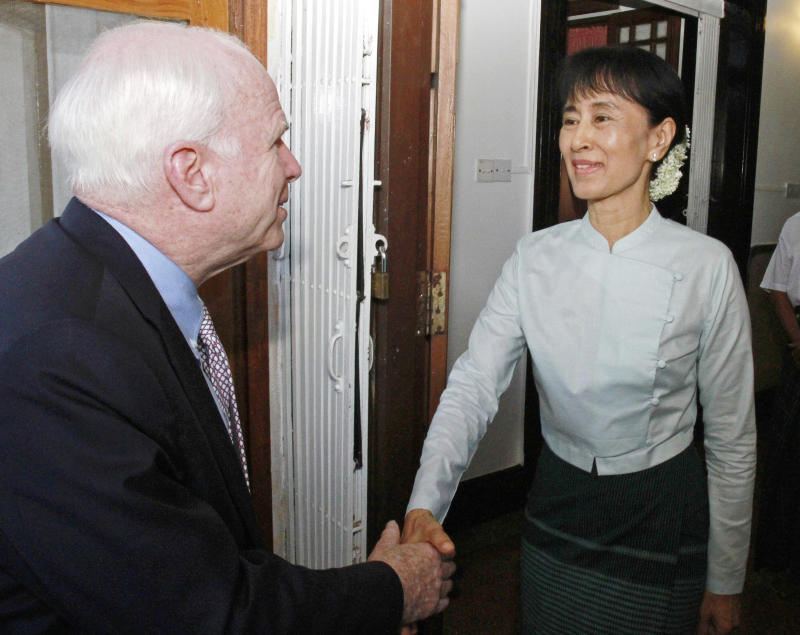 U.S. Sen. John McCain, left, bids farewell to Myanmar democracy icon Aung San Suu Kyi at her lake-side home after holding talks Thursday, June 2, 2011, Yangon, Myanmar. McCain began a brief trip to Myanmar on Wednesday to assess the situation in the country after a new civilian government promising reform took over from a military junta several months ago. (AP Photo/Khin Maung Win)