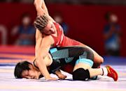 <p>Helen Louise Maroulis of United States competes against Rong Ningning of China during the Women's Freestyle 57kg 1/8 Final on day twelve of the Tokyo 2020 Olympic Games at Makuhari Messe Hall on August 4, 2021 in Chiba, Japan. (Photo by Wang Xianmin/CHINASPORTS/VCG via Getty Images)</p>