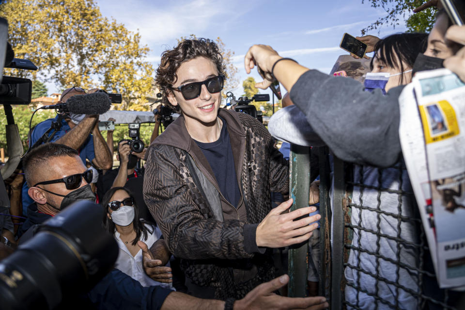 FILE - In this Sept, 3, 2021 file photo Timothee Chalamet meets fans upon arrival for the photo call of the film 'Dune' at the 78th edition of the Venice Film Festival in Venice, Italy. (AP Photo/Domenico Stinellis, File)