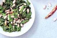 """This spicy and zesty upgrade on three-bean salad gets better the longer it marinates in its dressing, making it perfect make-ahead picnic fare. <a href=""""https://www.epicurious.com/recipes/food/views/bean-salad-with-lemon-and-herbs-51236510?mbid=synd_yahoo_rss"""" rel=""""nofollow noopener"""" target=""""_blank"""" data-ylk=""""slk:See recipe."""" class=""""link rapid-noclick-resp"""">See recipe.</a>"""