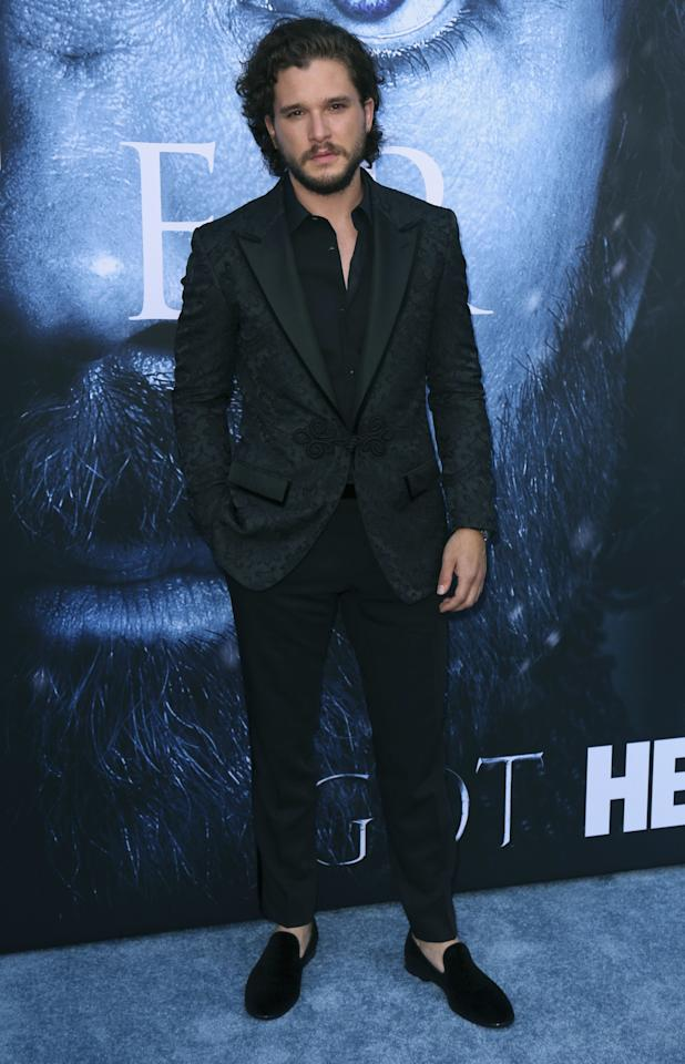<p>The GOT heartthrob turned it up in an ornately printed jacket and velvet smoking slippers.<br /><i>[Photo: AP]</i> </p>