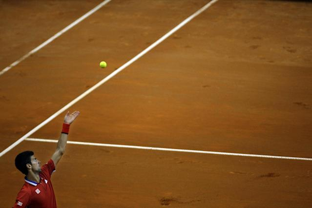 Serbia's Novak Djokovic gets ready to serve a ball to Canada's Vasek Pospisil during their Davis Cup semifinals tennis match in Belgrade, Serbia, Friday, Sept. 13, 2013. (AP Photo/ Marko Drobnjakovic)