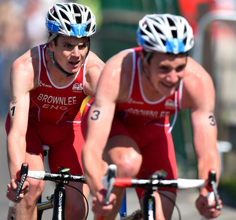 Alistair Brownlee (right) and Jonathan Brownlee compete in the Commonwealth Games men's triathlon at Strathclyde Country Park near Glasgow on July 24, 2014
