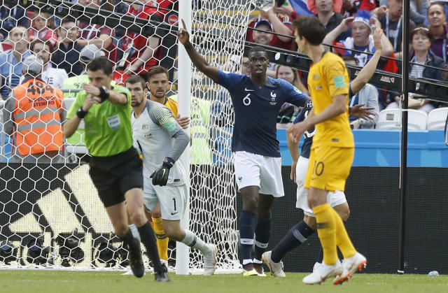 France's Paul Pogba, centre, reacts as the referee Andres Cunha from Uruguay, left, indicates that a goal has been given scored by Pogba during the group C match between France and Australia at the 2018 soccer World Cup in the Kazan Arena in Kazan, Russia, Saturday, June 16, 2018. (AP Photo/Pavel Golovkin)