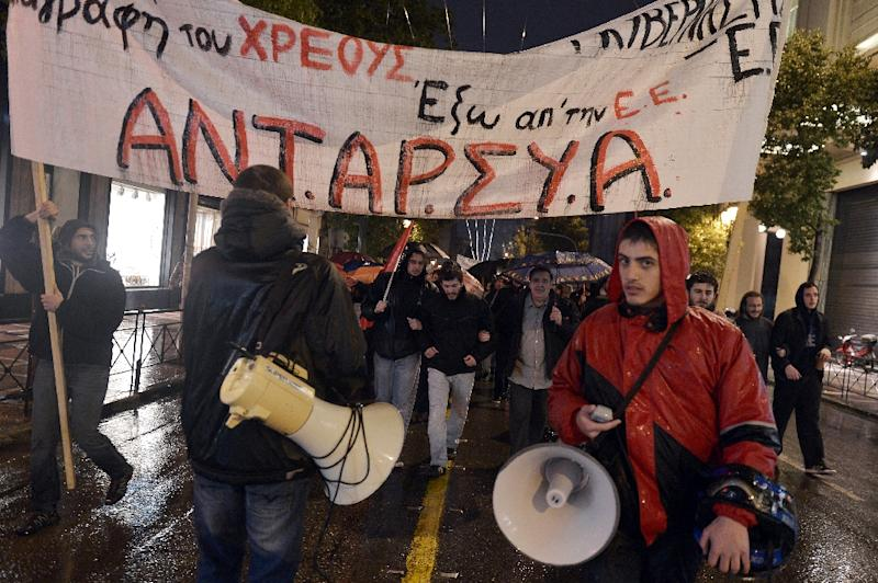 People carry a banner reading 'out of EU' and 'cancel the debt' during a demonstration in Athens on February 26, 2015 (AFP Photo/Louisa Gouliamaki)