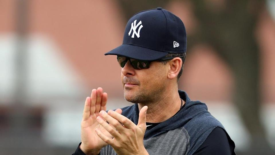 Feb 13, 2020; Tampa, Florida, USA; New York Yankees manager Aaron Boone (17) claps during spring training at George M. Steinbrenner Field. Mandatory Credit: Kim Klement-USA TODAY Sports