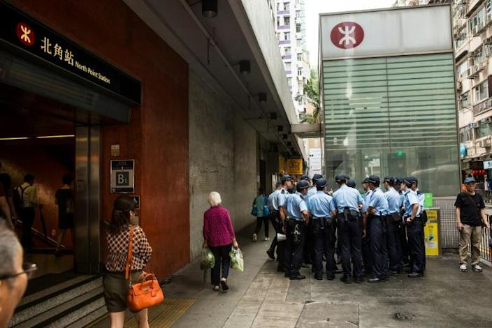 Police officers in turn condemned the city's number two official for offering a rare apology over the force's response to a suspected triad attack on protesters (AFP Photo/ISAAC LAWRENCE)