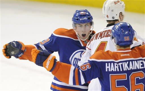 Edmonton Oilers' Ryan Nugent-Hopkins, left, celebrates his goal against the Calgary Flames with teammate Teemu Hartikainen, right, during the first period of an NHL hockey game in Edmonton, Alberta, on Friday, March 16, 2012. (AP Photo/The Canadian Press, John Ulan)