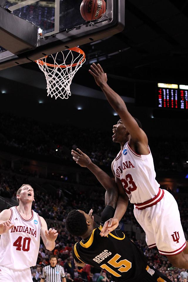 PORTLAND, OR - MARCH 17: Remy Abell #23 of the Indiana Hoosiers goes up for a shot over Juvonte Reddic #15 of the Virginia Commonwealth Rams in the second half during the third round of the 2012 NCAA Men's Basketball Tournament at the Rose Garden Arena on March 17, 2012 in Portland, Oregon. (Photo by Jed Jacobsohn/Getty Images)