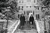 <p>Jackie moved out of the White House after her husband's death. The widow and her two small children stayed at a friend's residence in Georgetown before she bought a home of her own nearby. Here, Jackie leaves her new home with her sister, Lee Radziwill, and her decorators before moving in. </p>