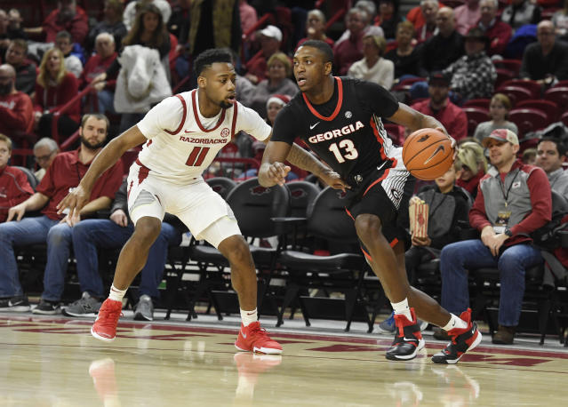 Georgia guard E'Torrion Wilridge (13) tries to get past Arkansas defender Keyshawn Embery-Simpson (11) during the first half of an NCAA college basketball game, Tuesday, Jan.29, 2019 in Fayetteville, Ark. (AP Photo/Michael Woods)