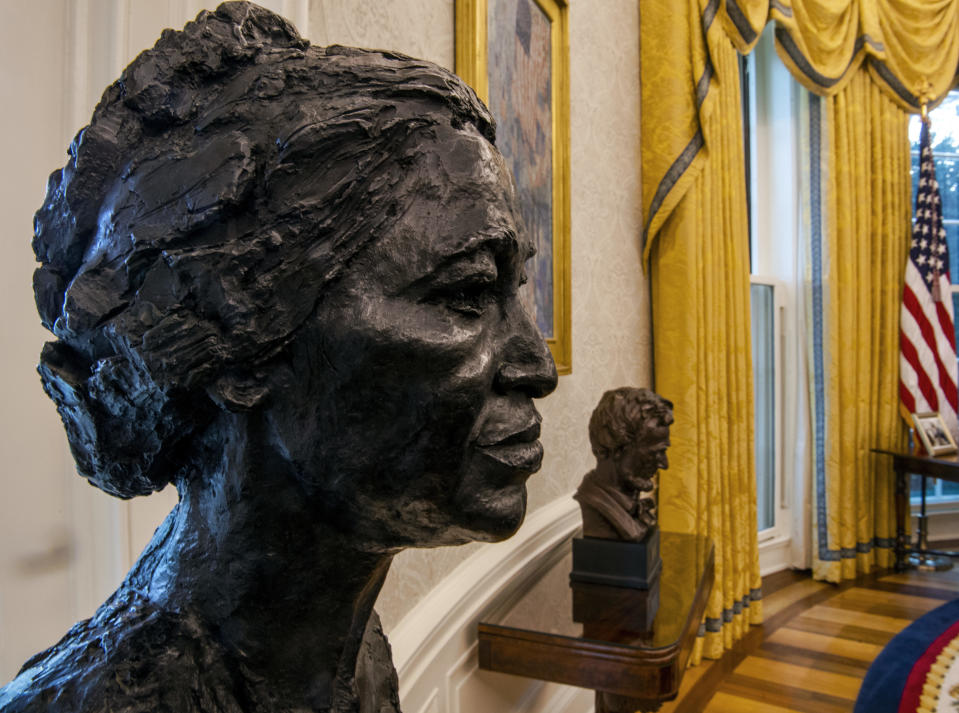 A sculpted bust of Rosa Parks, foreground, and Abraham Lincoln, right, on a table seen during an early preview of the redesigned Oval Office. / Credit: Bill O'Leary/The Washington Post via Getty Images