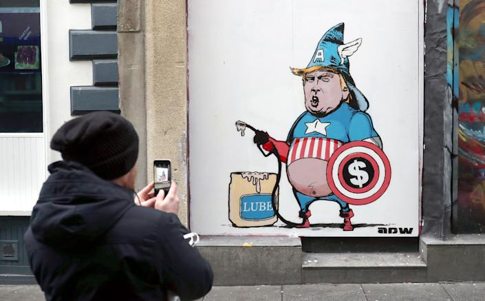 A mural lampooning US President Donald Trump in Dublin's Temple Bar by artist ADW.