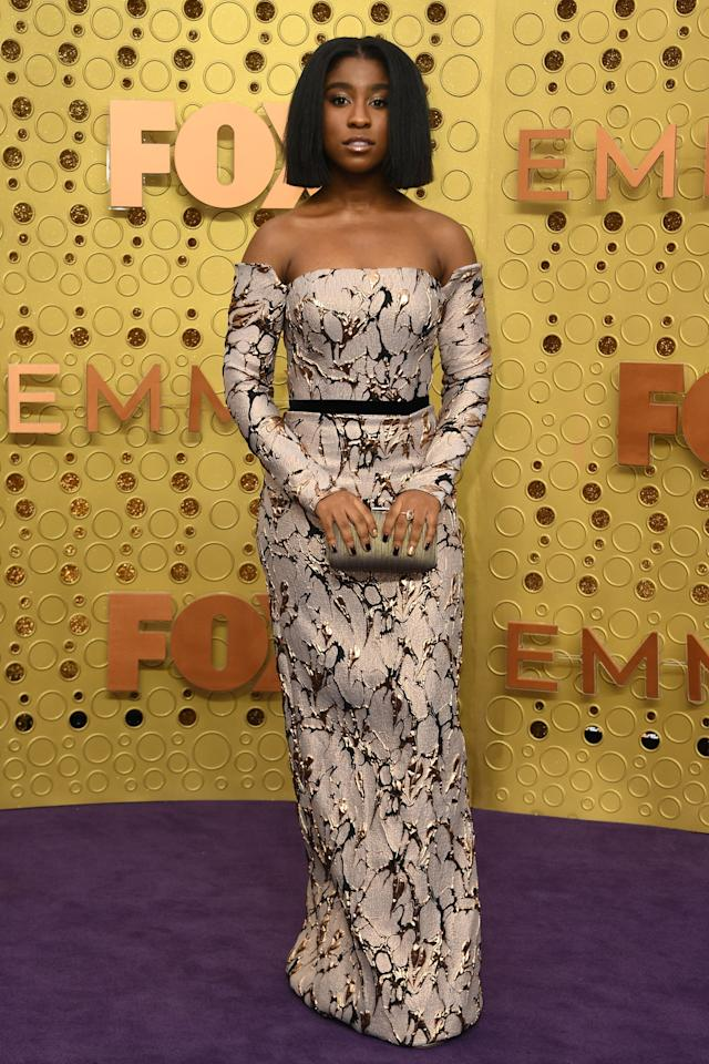<p>The <b>This Is Us</b> actress posed in an off-the-shoulder dress with a small clutch.</p>